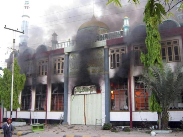 In this Thursday, March. 21, 2013 photo, smoke billows from a burning mosque following ethnic unrest between Buddhists and Muslims in Meikhtila, Mandalay division, about 550 kilometers (340 miles) north of Yangon, Myanmar. (AP Photo)