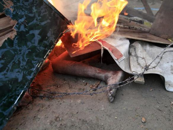 The body of a person is pictured on a street in Meikhtila. Image by: Soe Zeya Tun / REUTERS