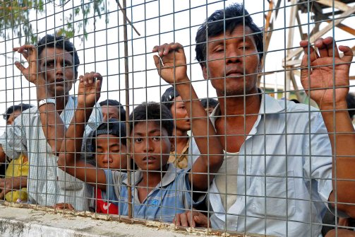 Muslim residents look out from a temporary relief camp after their evacuation from riot-hit Meiktila, central Myanmar on March 22, 2013. (Soe Than Win/AFP/Getty Images)